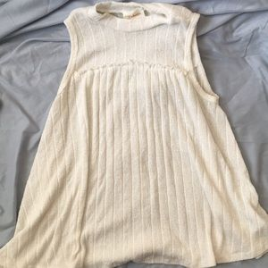 Sleeveless ivory light sweater material